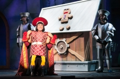 """I can see my future, and so it hall be done! It's total domination--with some torture just for fun!"" (David F.M. Vaughn is Lord Farquaad with 'Gingy"", the GIngerbread Man)"