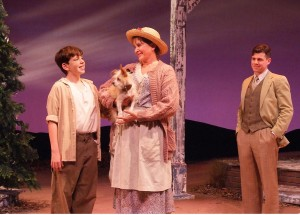 "William Spangler As Young Buddy Talks With Marsha Waterman As His Cousin ""Sook"" (With Pickle The Dog As ""Queenie"",) While Ciaran McCarthy As the Grown-Up Buddy Looks On"