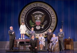 """I've just decided if my administration is going to be anything, it's gonna be optimistic about the future of this country!""  Gilgamesh Taggett As ""Oliver Warbucks"" Takes Issie Swickle As ""Annie"" To Meet Jeffrey B. Duncan As ""F.D.R."" & His Cabinet)"
