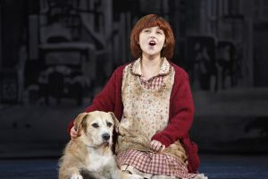 """When I'm stuck with a day that's gray and lonely, I just stick out my chin and grin..."" (Issie Swickle As ""Annie"" Sings To New Friend Sunny As ""Sandy"")  Issie Swickle Annie   LYNN ANDREWS Miss Hannigan   GILGAMESH TAGGETT Oliver Warbucks   ASHLEY EDLER Grace Farrell   GARRETT DEAGON Rooster Hannigan   LUCY WERNER Lily   Allan Ray Baker FDR   AMY BURGMAIER Mrs. Pugh, Ensemble, u/s Miss Hannigan   CAMERON MITCHELL BELL Bert, Ensemble   ANGELINA CARBALLO July, u/s Molly   JOHN CORMIER Ickes, Ensemble, u/s Rooster Hannigan   BRIAN COWING Bundles, Ensemble, u/s FDR   Adia Dant Pepper, u/s Annie   TODD FENSTERMAKER Drake, Ensemble, u/s Warbucks, FDR   CHLOE HORNER Swing   LILLYBEA IRELAND Tessie   EVAN MAYER Swing   JAKE MILLS Ensemble, u/s Bert   MEGHAN SEAMAN Ensemble, u/s Lily   HANNAH SLABAUGH Star to Be, Ensemble   SYDNEY SHUCK Kate   LILY EMILIA SMITH Ensemble, u/s Grace Farrell   LILLY MAE STEWART Molly   CHLOE TISO Swing   ISABEL WALLACH Duffy   Sunny Sandy   MACY u/s Sandy - See more at: http://anniethemusical.com/team.php#sthash.16bjwTB8.dpuf"