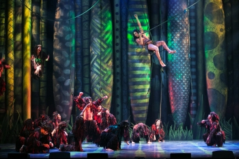 """""""All the things you dreamed of, all the visions that you saw, well, the time is drawing in now--it's yours to claim it all!"""" Devin Archer as """"Tarzan"""" and the cast celebrate in """"Son Of Man"""""""