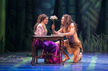 """""""Are these emotions racing through me? Tell me I must-Tell me I can…I never felt these things; I'm finding who I am"""" Katie DeShan as """"Jane"""" shares some happy time with Devin Archer as """"Tarzan"""""""