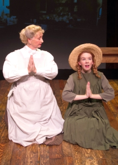 """Dear Father, I thank thee for the 'White Way Of Delight' and for the 'Lake Of Shining Waters""…and that's all the blessings I can think of right now."" Marina Coffee as ""Marilla"" teaches Angela Griswold as ""Anne"" the virtues of prayer"