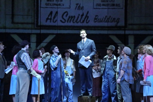 "Kevin Earley as ""Michael"" is determined to ""Do What We Need To Do"" to get the building finished as the company cheers him on."