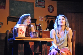 """Your life won't always work out for the best—every trial's not a test, nor each loss a lesson..."" Maya Sayre as ""Lisa"" acquaints Tara Shoemaker as her pal ""Waverly"" with some uncomfortable truths including that ""You Can't Be Everything You Want"""