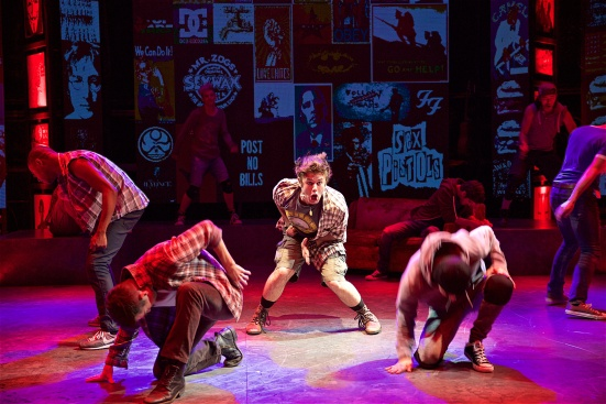 "Welcome to a new kind of tension all across the 'Alien-Nation, where everything isn't meant to be okay!"" Jackson Hinden (center) stars with the company in ""The La Mirada Theatre For The Performing Arts"" ""Onstage"" production of ""American Idiot"""