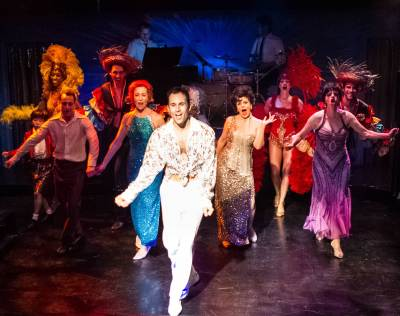 """When my baby…when my baby smiles at me the sun'll lighten--up my life and I am free at last! What a blast!"" Andrew Bongiorno as ""Peter Allen"" leads the company in a rousing rendition of his hit ""I Go To Rio"" in the ""Celebration Theatre's"" West Coast premiere of ""The Boy From OZ"