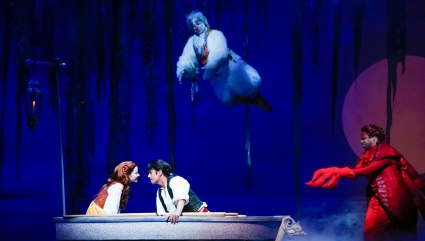 """Now's your moment--floating in a blue lagoon. Boy you better do it soon--no time will be better! She don't say a word, and she won't say a word until you kiss the girl"" Jamie Torcellini as ""Scuttle"" and Melvin Abston as ""Sebastian"" try to create a romantic mood for Alison Woods as ""Ariel"" and Eric Kunze as ""Prince Eric"" in ""The La Mirada Theatre For The Performing Arts"" & McCoy-Rigby Entertainment Production Of Disney's ""The Little Mermaid"""