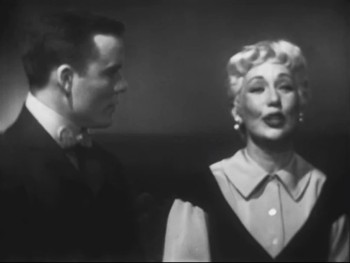 """I do not care if that day arrives—that dream need never be, if the ship I sing doesn't also bring my own true love to me…"" Ann Sothern as ""Liza Elliott"" recalls a moment with James Congdon as ""Ben Butler"" the boy who broke her heart in a pivotal moment from ""Lady In The Dark"""