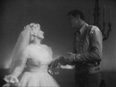 """This is new…you've got me so I'm spell-bound; I don't know if I'm Heaven or Hell-bound !"" Ann Sothern as ""Liza Elliott"" dreams she's about to marry Robert Fortier as 'Matinee Idol' ""Randy Curtis"""