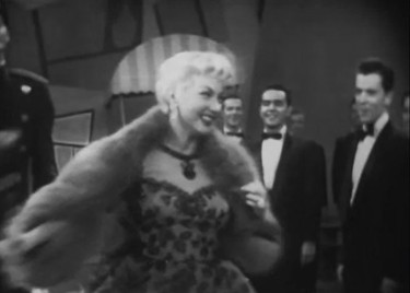 """In all my flights of fancy your image I drew—I look at you and I can see that fancy come true!"" Ann Sothern as ""Girl Of The Moment"" ""Liza Elliott"" is serenaded by her adoring admirers in ""Lady In The Dark"""