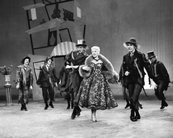 """Oh, 'fabulous one' in your Ivory Tower, my heart and I both agree: what Juliet was to Romeo, are you to me…"" Ann Sothern as ""Liza Elliott"" frolics with a band of doting street-people in the first ""Glamour Dream"" sequence in ""Lady In The Dark"""