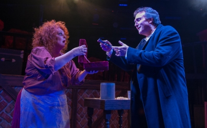 """Them handles is chased silver ain't they?"" Beth Hansen as ""Mrs. Lovett 're-acquaints' David Stoneman as ""Sweeney Todd"" with some 'old friends' in ""One More Productions' ""Sweeney Todd, The Demon Barber Of Fleet Street"""