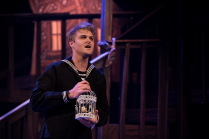 """I was half convinced I'd wakened--satisfied enough to dream you; happily I was mistaken, Johanna…"" Josh Switzer as the young sailor ""Anthony Hope"" has glimpsed the girl of his dreams in ""One More Productions' ""Sweeney Todd, The Demon Barber Of Fleet Street"""