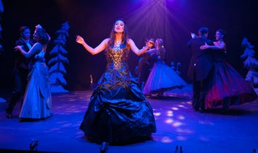 """It's that time of year when the world falls in love; every song you hear seems to say 'Merry Christmas, may your New Year dreams come true!"" Erika Baldwin leas the company in ""The Christmas Waltz"" in One More Productions' ""The Holiday Gem"""