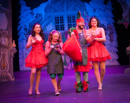 """It'll nearly be like a picture print by 'Currier and Ives'; these wonderful things are the things we'll remember all through our lives!"" Megan Michell as ""Emma The Elf"" and John Gillies as ""Ernie The Elf"", with Sophia Scarsi (L) and Nicole Cassesso (R) extoll the virtues of a good old fashioned ""Sleigh Ride"" in One More Productions' ""The Holiday Gem"""