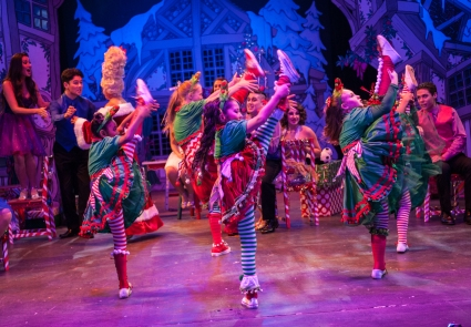 """Let's deck the halls with holly, sing sweet silent night! Fill the tree with angel hair--and pretty, pretty lights!"" Younger members of the cast demonstrate with some dynamic moves in One More Productions' ""The Holiday Gem"""