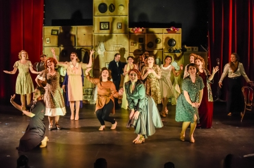"""""""Henry Street—No, it ain't Broadway—it's Henry Street; long after midnight it's lit-up as bright as a lighthouse—brighter tonight that 'The White House'!"""" The cast celebrates """"Fanny's"""" debut in """"The Ziegfeld Follies"""" in """"The Conundrum Theatre's Production Of """"Funny Girl"""""""