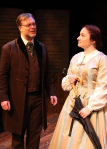 """""""If I have noticed nothing else about you, Miss March, I have noticed that you are unique. Something you should try not to forget. I think you could do better."""" Nicholas Thurkettle as """"Professor Bhaer"""" chides Ashley Arlene Nelson as """"Jo"""" regarding her """"Blood and Guts stuff"""" manuscript in """"The Chance Theater's """"Little Women—The Broadway Musical"""""""
