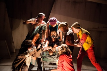 """Look at her there, all bound up, gagged and tied! With her head full of hair and her heart full of pride!"" With ""Hope"" as their hostage, the revolting rabble debate what to do with her in ""The Coeurage Theatre Company's"" production of ""Urinetown: The Musical"""