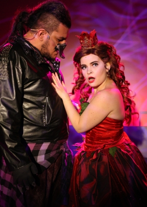 """""""I will love you around the clock, with my enormous, Platypus…Heart!"""" Miguel Cardenas as """"Bruiser"""" tries to make Kim Dalton as """"Princess Poinsettia"""" see that parts of him aren't so bad in """"The Chance Theater's production of """"Claudio Quest"""""""