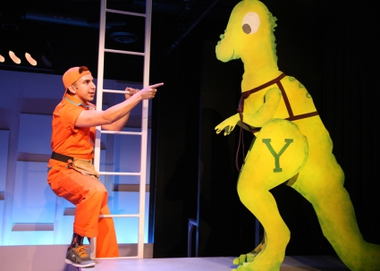 """My brother, he's got the touch—HE comes through in a clutch; me, well not so much, so while he's off being great, I focus on my job, carrying the pack, helping where I can, but mostly standing in the back…  ""  Andrew Puente as ""Luis""  (with Y, the Dinosaur as himself) ponders his fate at being ""Player Number Two"" in ""The Chance Theater's"" production Of ""Claudio Quest"""